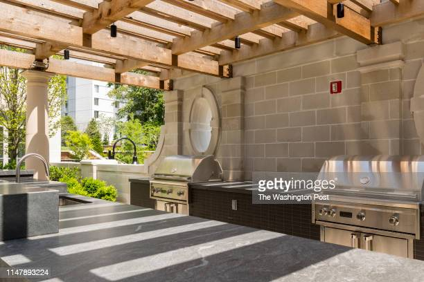 Outdoor Kitchen with Grills in the Shared Courtyard at The Signet on May 28 2019 in McLean Virginia