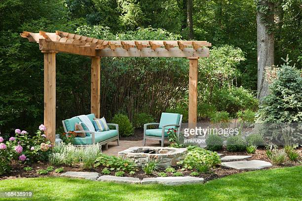 outdoor living space with portcullis. - fire pit stock pictures, royalty-free photos & images