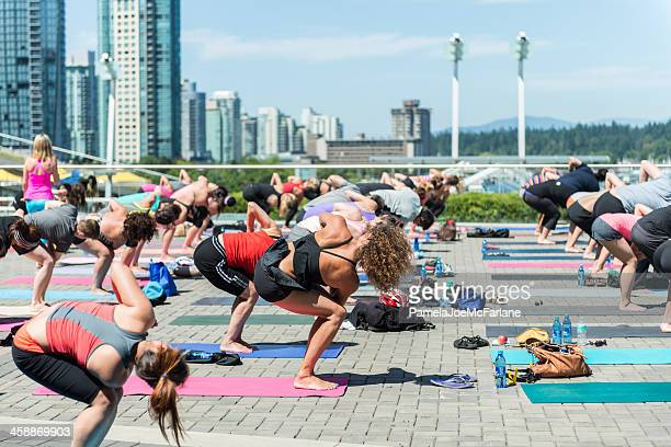 outdoor lunch hour yoga - lululemon stock pictures, royalty-free photos & images