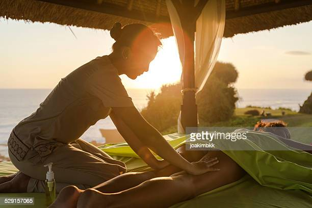 Outdoor massage at sunset by the seaside