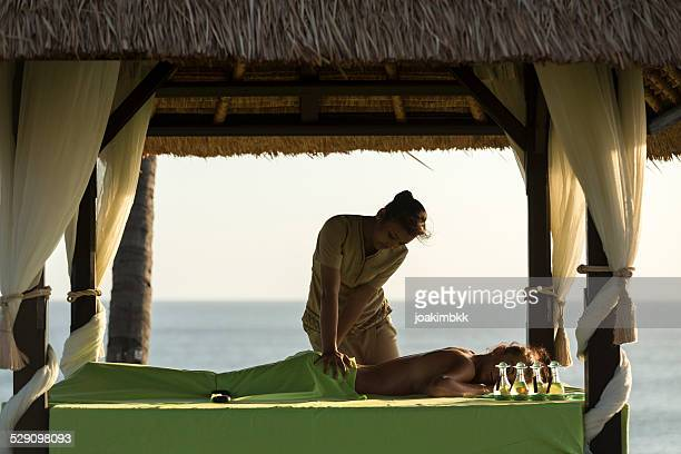 outdoor massage treatment under a gazebo - gazebo stock pictures, royalty-free photos & images
