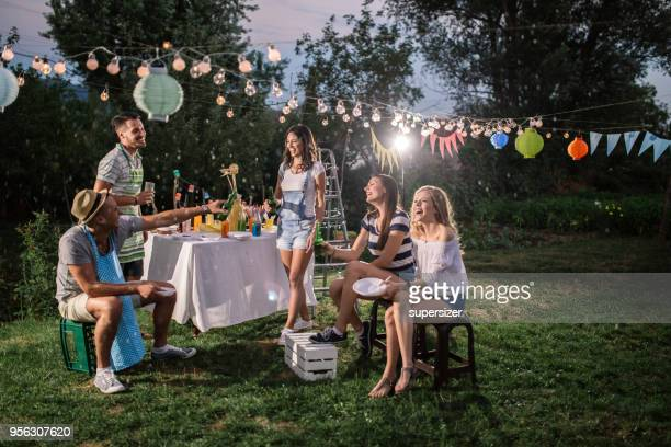outdoor party - barbecue social gathering stock pictures, royalty-free photos & images