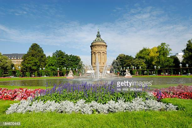 Outdoor photo Mannheim fountain with blooming flowers