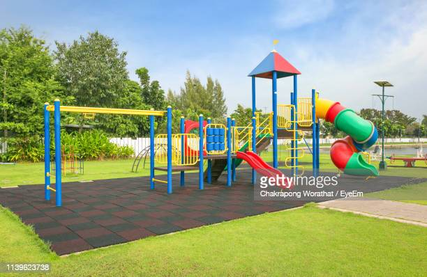 outdoor playing equipment on playground - spielgerät stock-fotos und bilder
