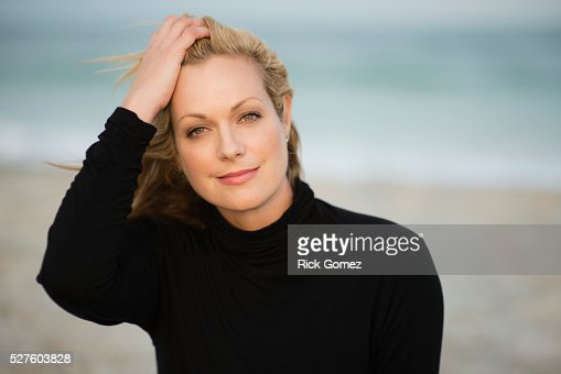 outdoor portrait of a beautiful mid 40s blonde woman stock photo