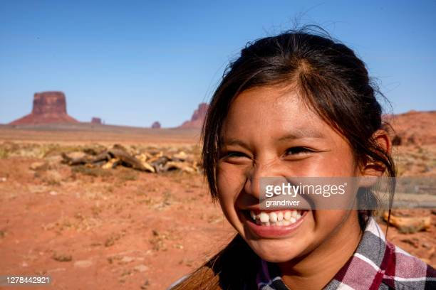 outdoor portrait of a beautiful navajo native american indian girl in the northern arizona desert on the monument valley indian reservation - cherokee indian women stock pictures, royalty-free photos & images