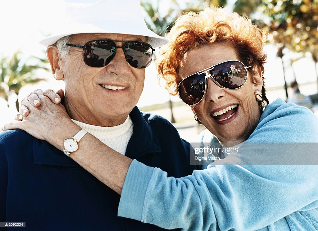 Outdoor Portrait of a Happy Senior Couple Wearing Sunglasses : Stock Photo