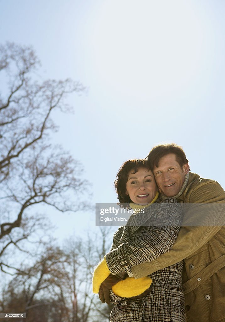 Outdoor Portrait of a Mature Couple In Winter Clothing Embracing : Stock Photo