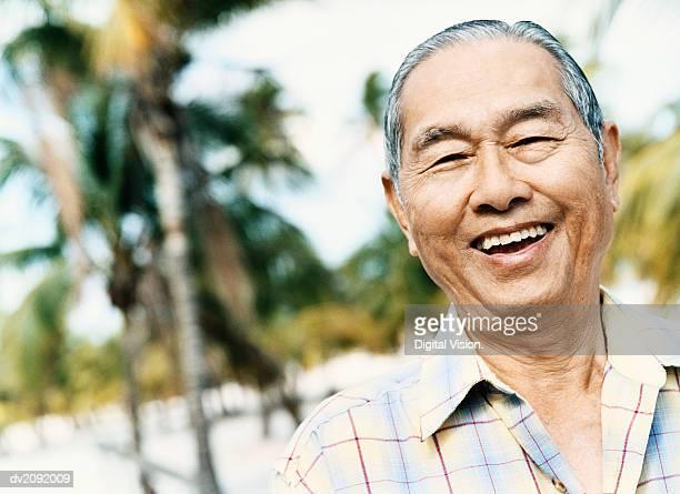 outdoor portrait of a senior man, laughing - 60代 ストックフォトと画像