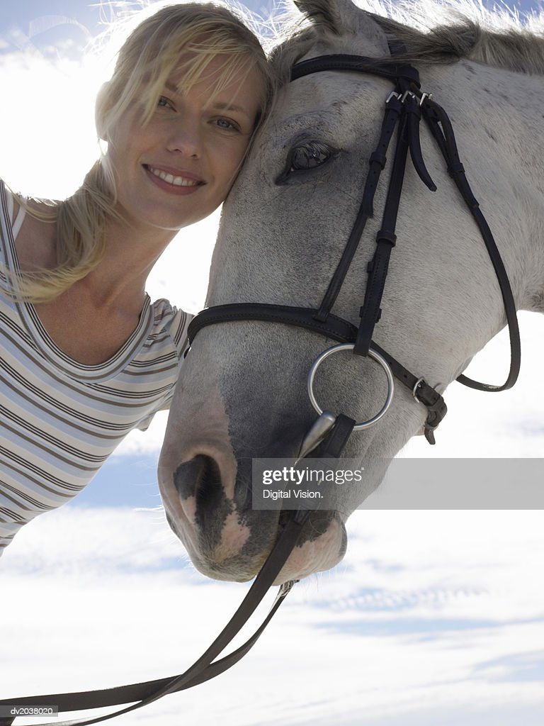 Outdoor Portrait of a Woman With Her Pet Horse : Stock Photo