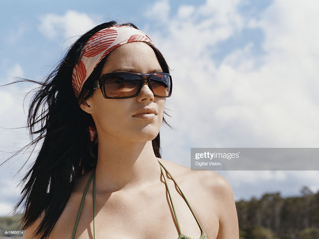 Outdoor Portrait of a Young Woman Wearing Sunglasses and a Headband : Stock Photo