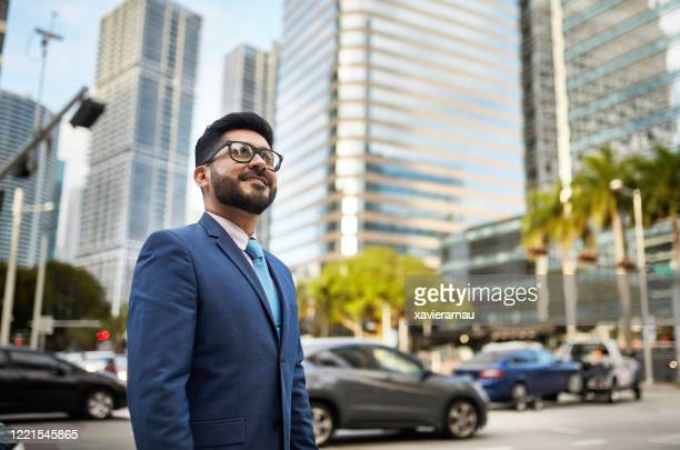 outdoor portrait of ambitious hispanic businessman in miami - mid adult stock pictures, royalty-free photos & images