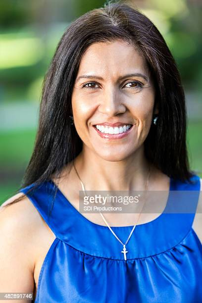 Outdoor portrait of beautiful mature Hispanic woman