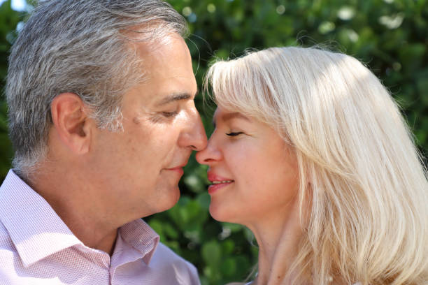 outdoor portrait of close up middle age woman and man caucasian couple