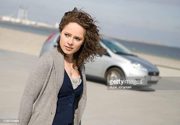 Outdoor portrait of Danish woman, 26 years old, looking off to the side at Amager Strandpark, Copenhagen, Denmark