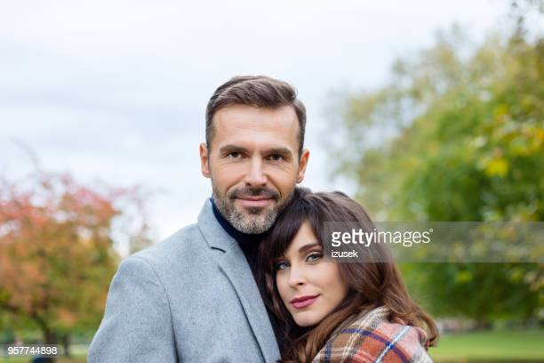 outdoor portrait of elegance couple embracing in the park - hyde park london stock pictures, royalty-free photos & images