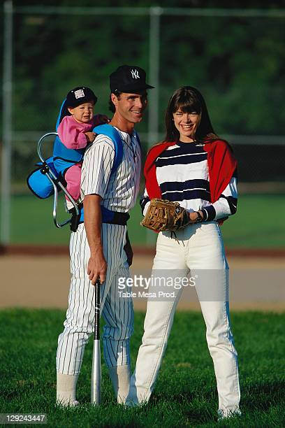 actli052 outdoor portrait of family in baseball at - baseball mom stock pictures, royalty-free photos & images