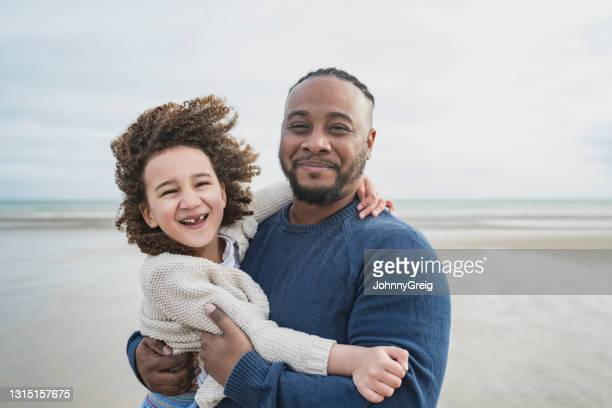 outdoor portrait of father and young daughter on vacation - wind stock pictures, royalty-free photos & images