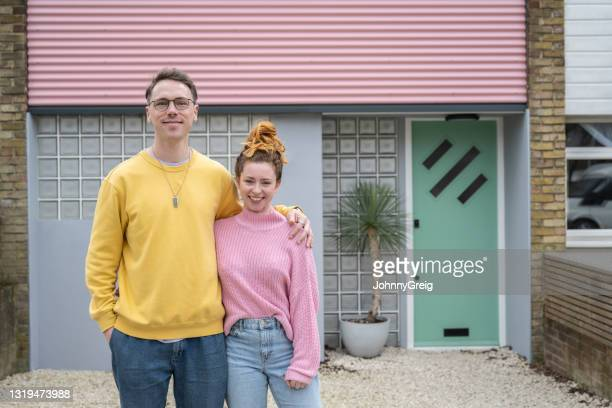 outdoor portrait of first-time home owners - mid adult couple stock pictures, royalty-free photos & images