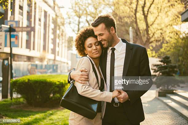 outdoor portrait of flirting elegant couple - izusek stock pictures, royalty-free photos & images