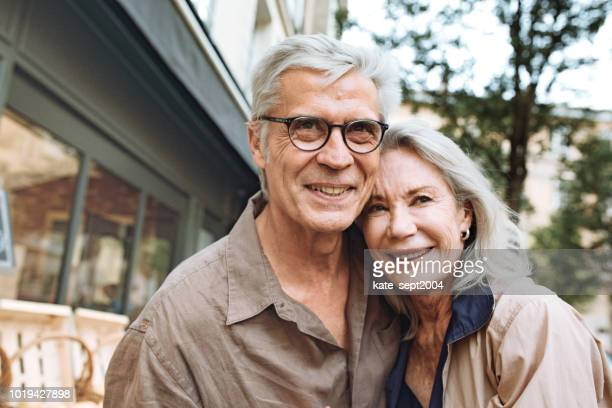 outdoor portrait of happy senior couple - life insurance stock pictures, royalty-free photos & images