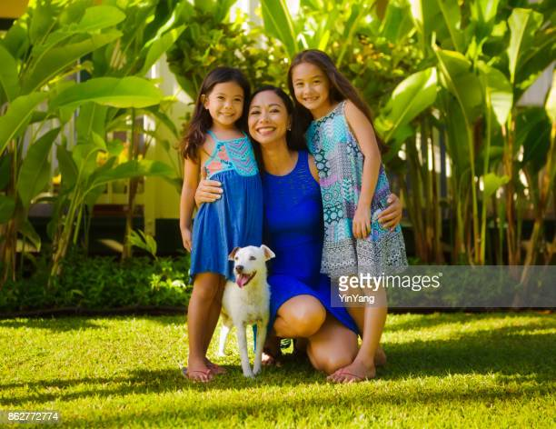 Outdoor Portrait of Hawaiian Polynesian Family with Mother, Children and pet dog