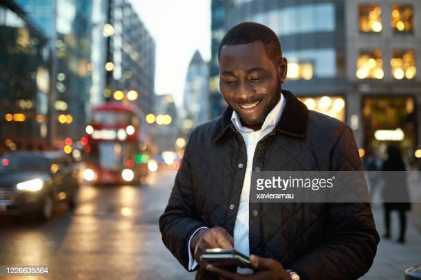 outdoor portrait of london businessman after work - open collar stock pictures, royalty-free photos & images