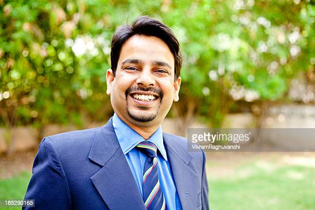 Outdoor Portrait of One Confident Cheerful Indian Businessman