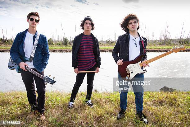Outdoor portrait of rock band.