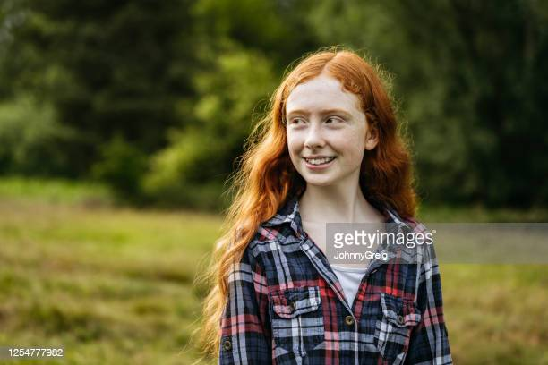 outdoor portrait of smiling adolescent girl in woodland area - girls stock pictures, royalty-free photos & images