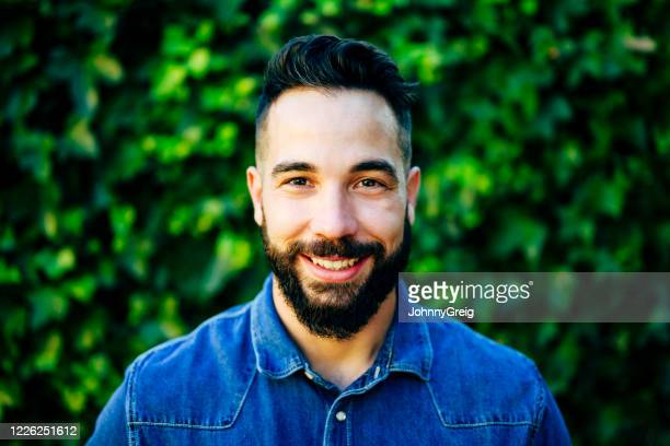 outdoor portrait of smiling mid adult spanish man - half shaved hairstyle stock pictures, royalty-free photos & images