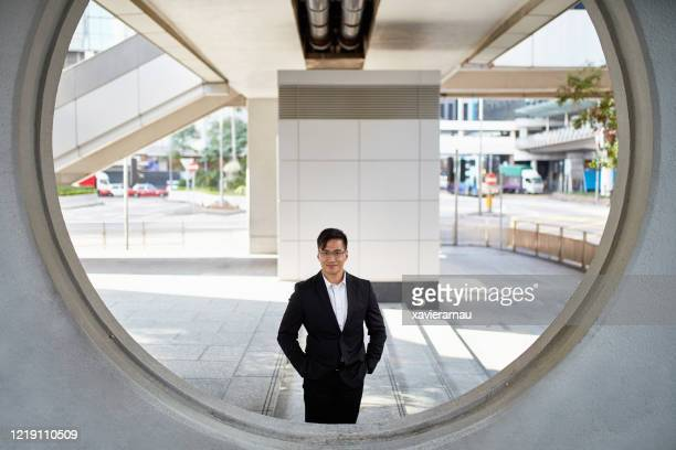 outdoor portrait of successful chinese business professional - open collar stock pictures, royalty-free photos & images