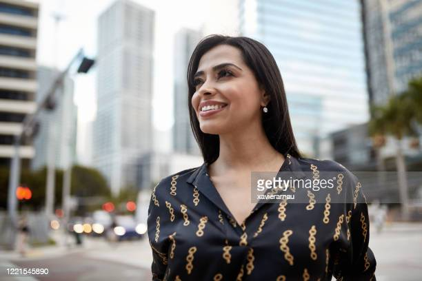 outdoor portrait of successful hispanic miami businesswoman - black hair stock pictures, royalty-free photos & images