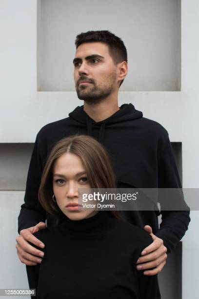 outdoor portrait of the stylish couple - defending stock pictures, royalty-free photos & images