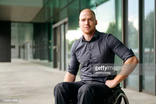 outdoor portrait of young businessman in wheelchair - wheelchair stock pictures, royalty-free photos & images