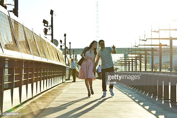 Outdoor portrait of young couple in the city at sunset