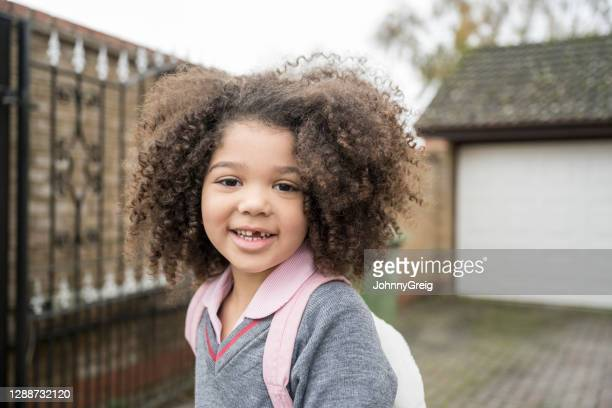 outdoor portrait of young mixed race girl in school uniform - mid length hair stock pictures, royalty-free photos & images