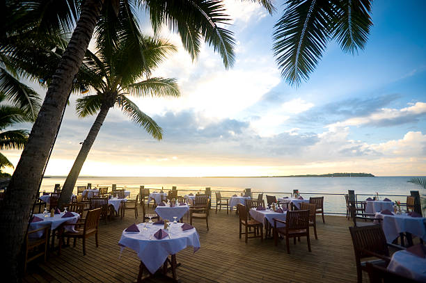 Outdoor Resort beach restaurant at sunset