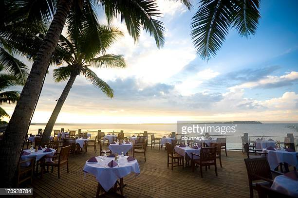 outdoor resort beach restaurant at sunset - tourist resort stock pictures, royalty-free photos & images