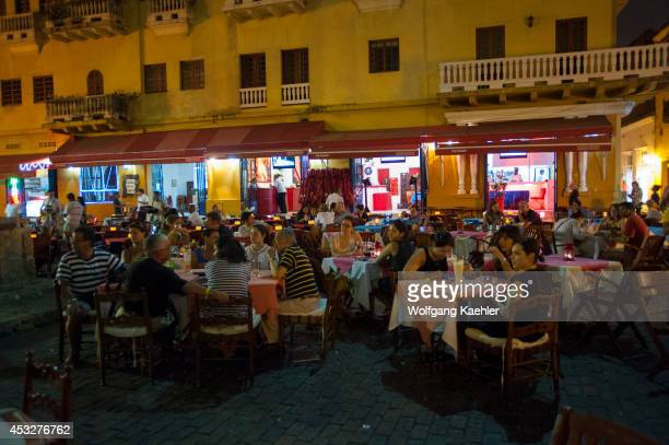 Outdoor restaurants at night on Plaza Santo Domingo in Cartagena Colombia a walled city and Unesco World Heritage Site