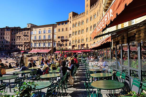 outdoor restaurants,  piazza cel campo,  siena - siena italy stock photos and pictures