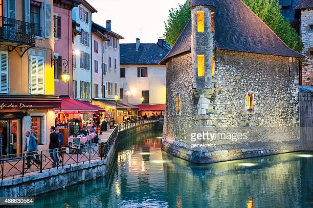 outdoor restaurants, spring evening, annecy, france, palais de l - lake annecy stock photos and pictures