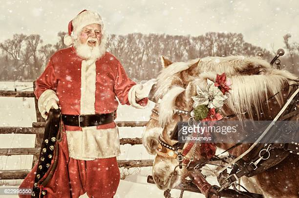 outdoor santa with a team of horses and hand bells - country christmas stock pictures, royalty-free photos & images