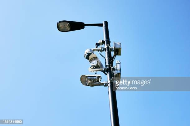 outdoor security cameras in inner city - business security camera stock pictures, royalty-free photos & images