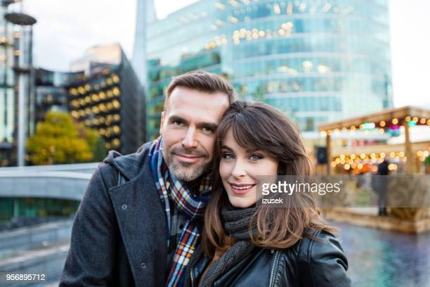 Outdoor shot of couple standing in a London city