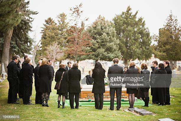 outdoor shot of funeral - funeral stock pictures, royalty-free photos & images