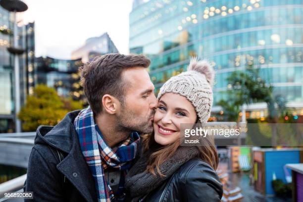 Outdoor shot of happy couple embracing in a London city