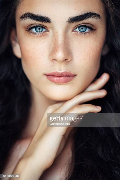 outdoor shot of young beautiful woman - blue eyes stock pictures, royalty-free photos & images