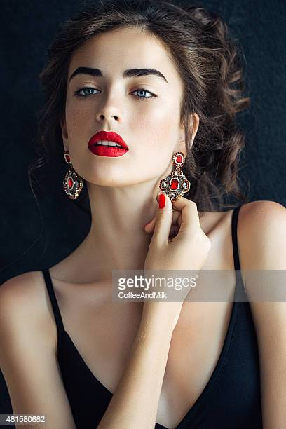 outdoor shot of young beautiful woman - earring stock pictures, royalty-free photos & images