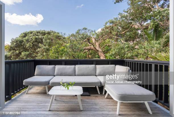 outdoor sofa on deck. - north island new zealand stock pictures, royalty-free photos & images